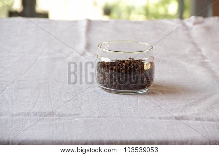 Coffee Grains In Transparent Bank