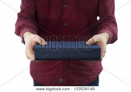 Man holding closed book isolated on white