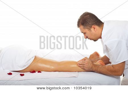 Masseur Kneading Woman Leg