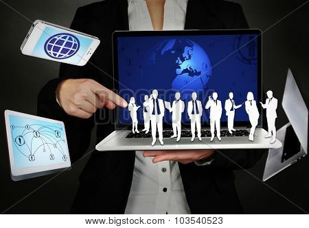 Businessman holding social object