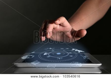 Businessman hand pushing business graph on tablet-pc.  Futuristic button