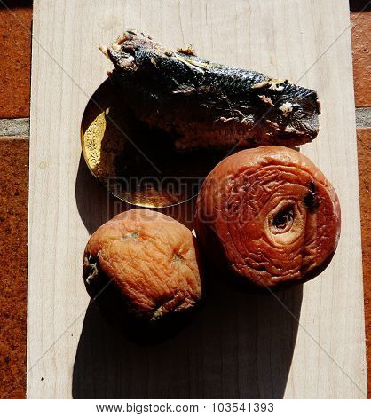 rotten peach and fish wooden brick background