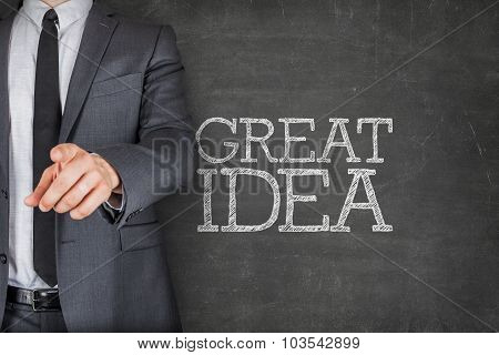 Great idea on blackboard with businessman
