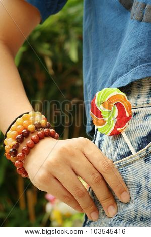 Colorful Of Candy In A Jeans Pocket.