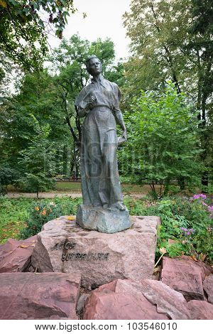 Beautifully Rendered Sculpture Of Historical Writer And Poet, Lesya Ukrainka, Stands On A Stone Slab