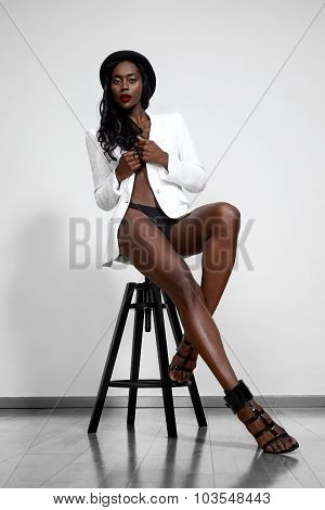 Topless Black Woman Wearing White Jacket And Hat