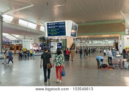 Passengers Approaching The International Departures Area At Kuala Lumpur International Airport In Ma