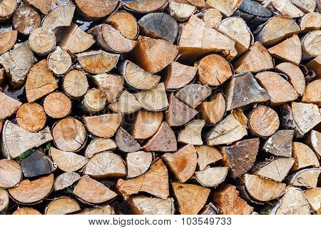 Chopped And Stacked Up Dry Firewood As Background