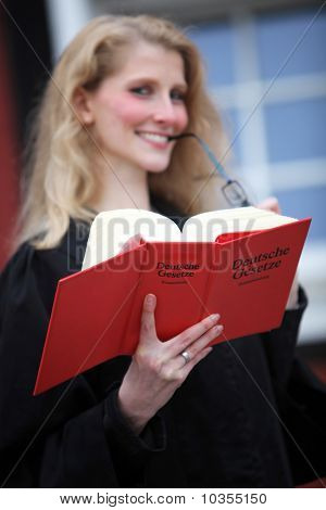 Law Book With Law Student Or Lawyer In The Background