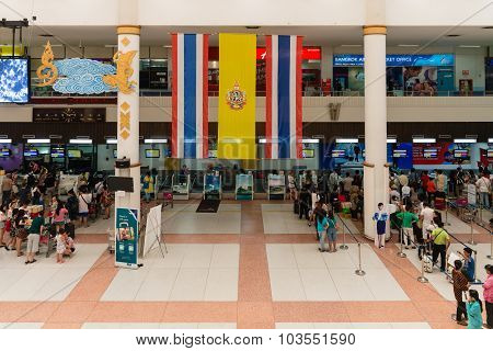 Registering Check-in Desks With Hanged Over Big Thai Flag In Airport