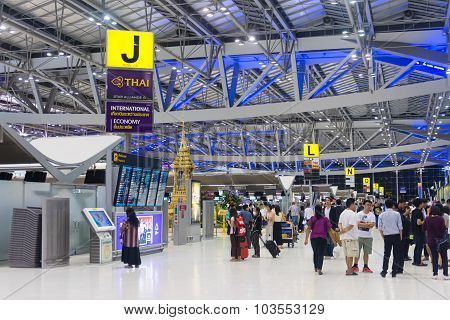 Crowd Of Passengers Passing Through The Departures Area Of Suvarnabhumi Airport's Main Terminal.