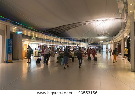 Passengers Walk Past A Shopping Area On Their Way To The Departure Gates At One Of Suvarnabhumi Airp