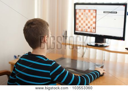 Little Boy Play Online Chess At Home