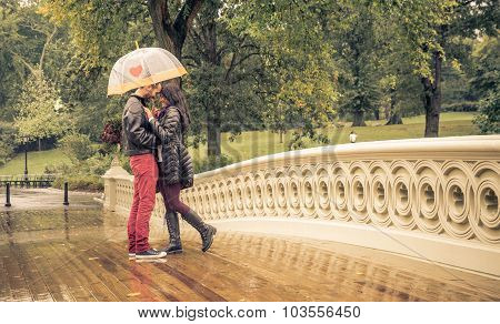 Couple Sharing Romantic Emotions In A Rainy Day In Central Park, New York