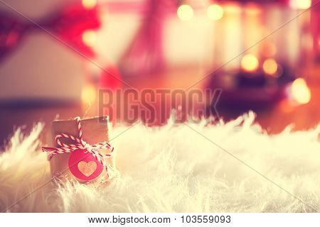 Small Christmas Gift With Heart Tag At Night