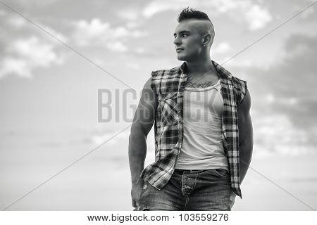 Handsome Athletic Man Looking Away Against Sky