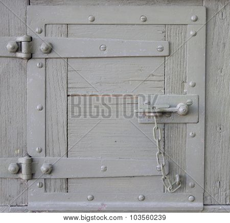 Old Latch On A Wooden Door