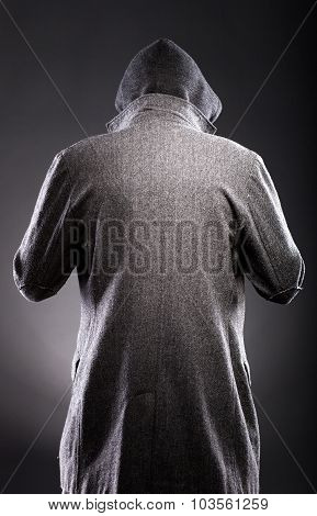 Young Man In Winter Coat And Hood Rear View