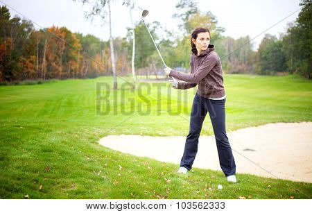 Woman Player Training On Golf Course, Preparing To Shot