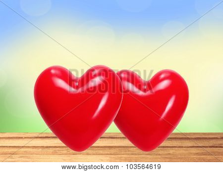 Red Hearts On Wooden Table Over Nature Background