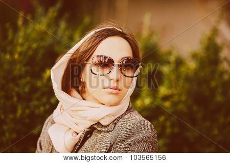 girl sitting on a bench in the park
