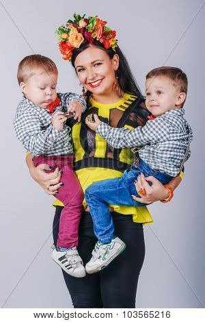 Mother With Her Two Sons In Studio