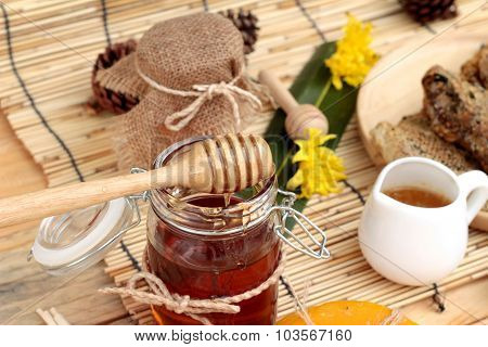 Honey Variety With Honeycomb And Honey In A Jar With Beeswax.