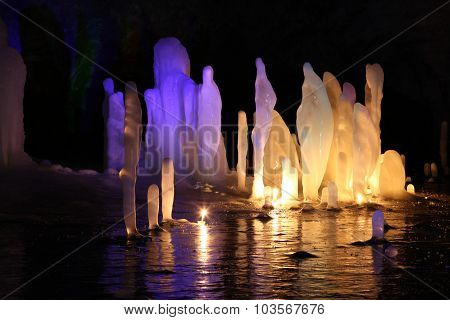 Frozen Water Stalagmite In Deep Marble Cave, Russia