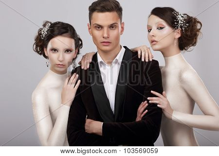 Two Young Women And Trendy Man