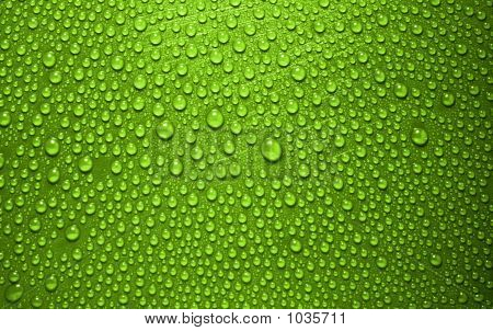 Picture or Photo of Close up of green waterdrops from above