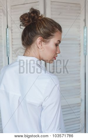 Portrait of young beautiful woman rearview