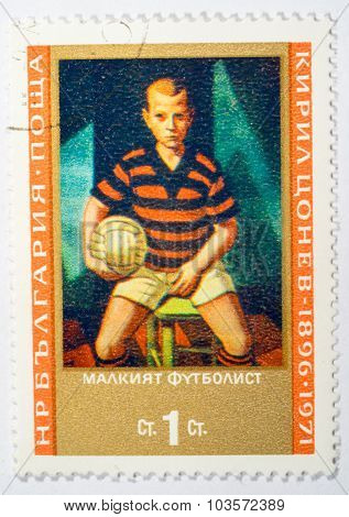 Moscow, Russia - October 3, 2015: A Stamp Printed In Bulgaria Shows Little Footballer By Cyril Tsone