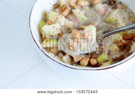 Oatmeal With Fresh Apples, Peanuts And Raisins