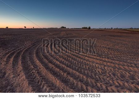 Beautiful Landscape With Plowed Field Under Sky