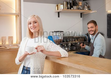 Cheerful male worker of cafeteria is serving customer
