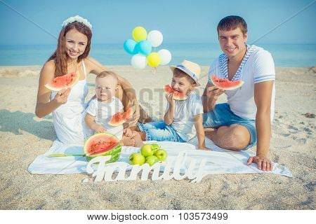 Family With Watermelon On The Beach