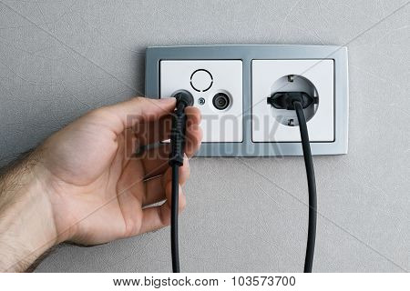 Plugging Cable To Outlet