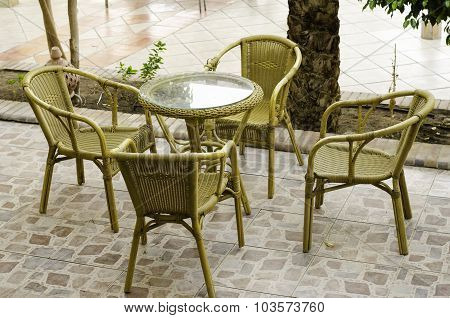 Table And Wicker Chairs.