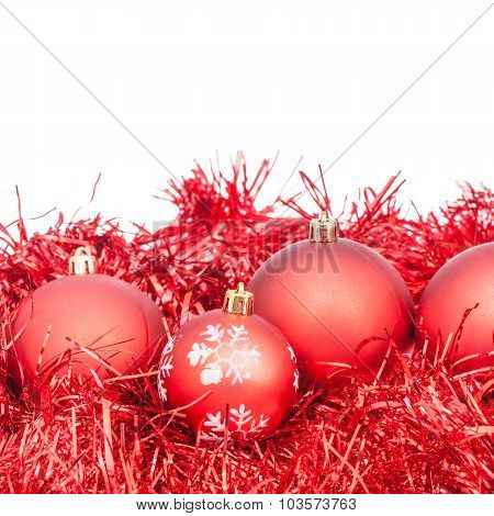 Few Red Xtmas Balls And Tinsel Isolated