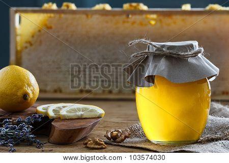 Honey Jar And Lemon Pieces