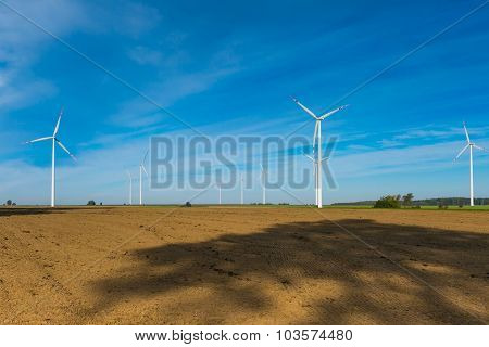 Plowed Fields And Wind Farm
