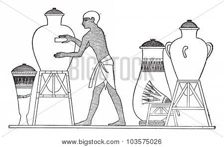 Egyptian finishing a vase, vintage engraved illustration.
