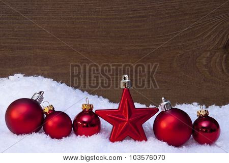 Wooden Christmas Background On Snow, Red Balls And One Star
