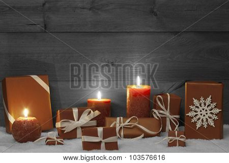 Christmas Decoration With Orange Candles, Presents And Snow
