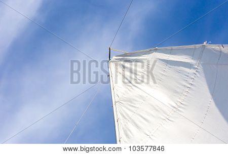 Close Up Of Yacht Mast And Sail