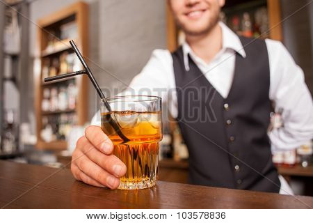 Cheerful male barman is working in bar