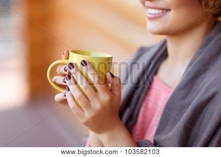 Delighted girl drinking tea