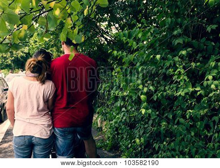 Couple Holding Together Outside By The Green Scenery