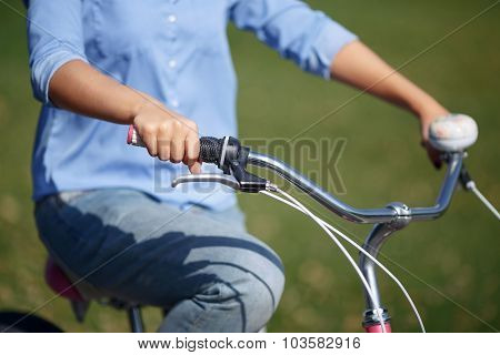Active girl riding a bicycle