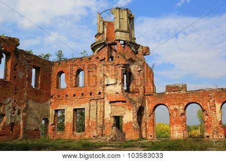 Ruins of abandoned old castle in sunny day